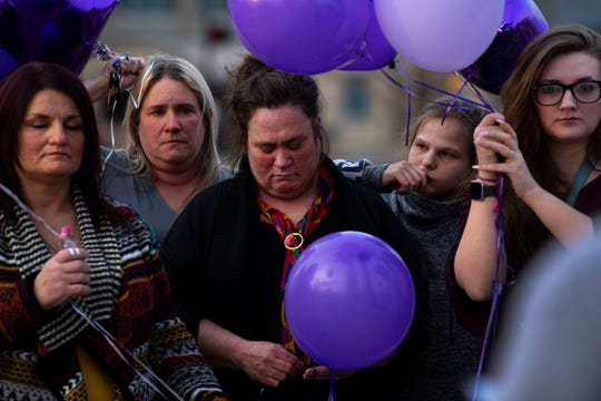 Renee Mueller of Evansville, center, is surrounded by family and friends as she attends the memorial service for her daughter, Chloe Randolph-Abdikadir, at the Four Freedoms Monument on the riverfront in Downtown Evansville Wednesday evening. A majority of the 150-plus balloons released at sunset were purple to call attention to domestic violence. The 20-year-old Henderson, Ky., resident was found murdered March 23, 2019, and her husband, Mohamud Abdikadir is being held without bail in the Henderson County Detention Center for the murder.
