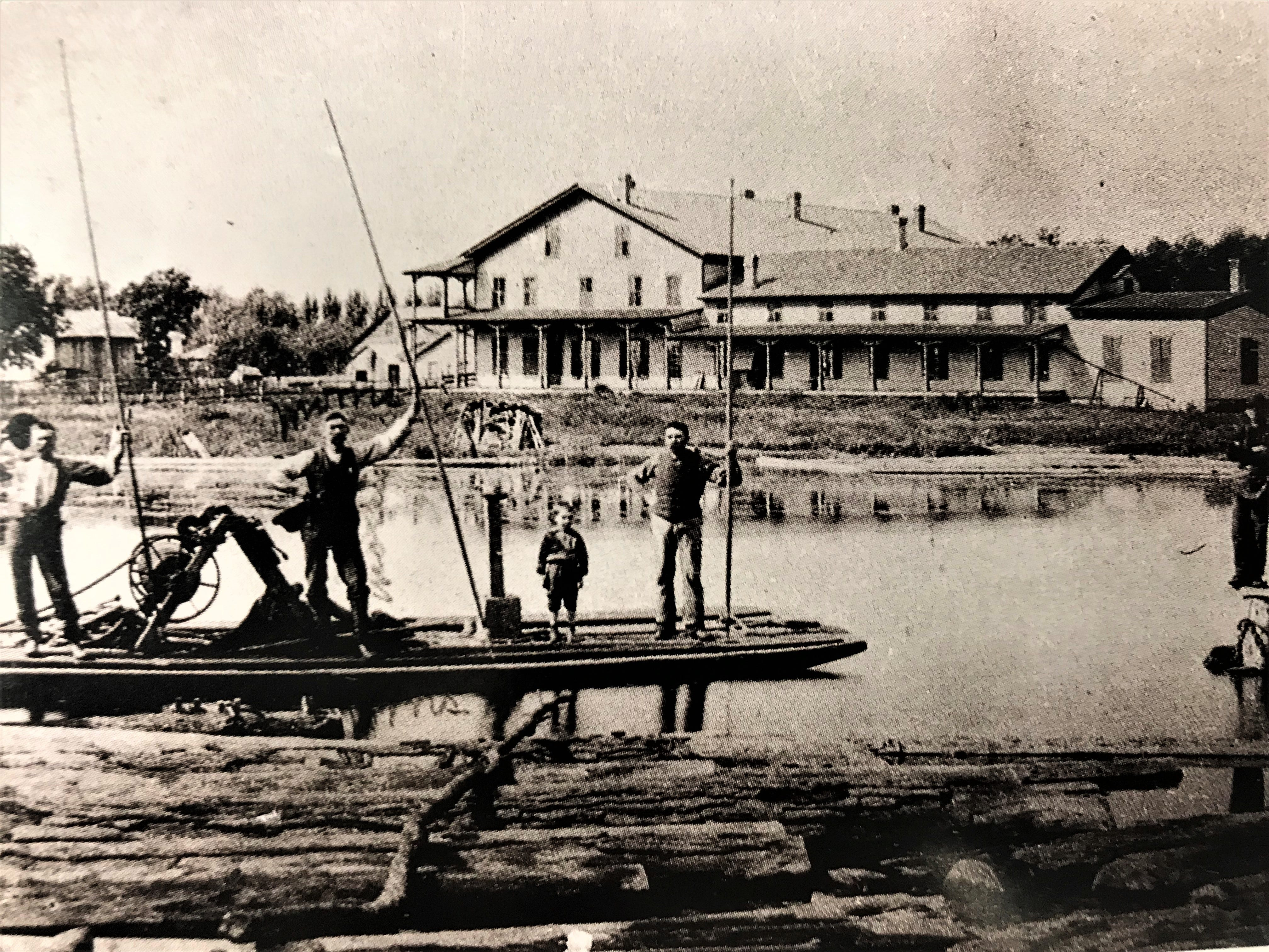 Lumberman from Moore and Galloway Mill sort logs along the bank of the Fond du Lac River, south of Scott Street. The Moore and Galloway Mill survived three fires, but by the end of  the first decade of the 1900s lumber mills had disappeared from the shores of Lake Winnebago and the Fond du Lac River.