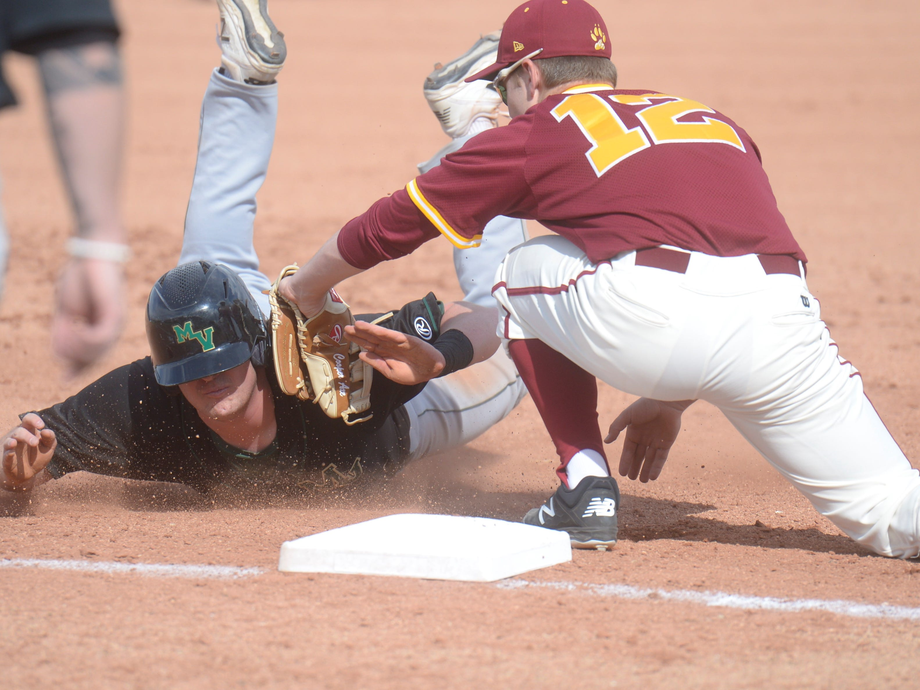 Rocky Mountain baseball third baseman Cooper Axe tags out a runner trying to advance during a game Wednesday, April 3, 2019 against Mountain Vista. Mountain Vista won 10-2.