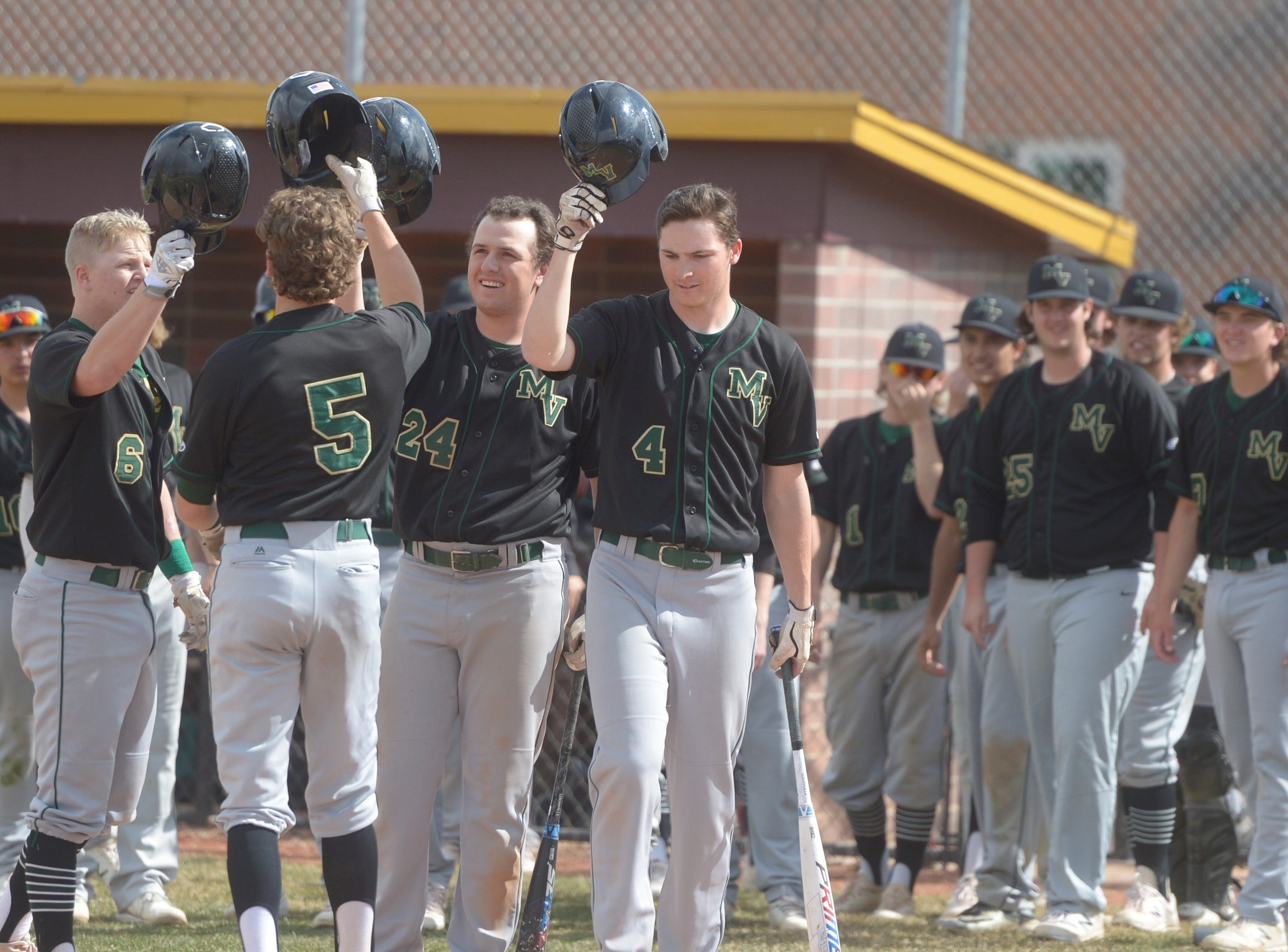 Mountain Vista baseball players celebrate a home run during a game Wednesday, April 3, 2019 against Rocky Mountain. Mountain Vista won 10-2.