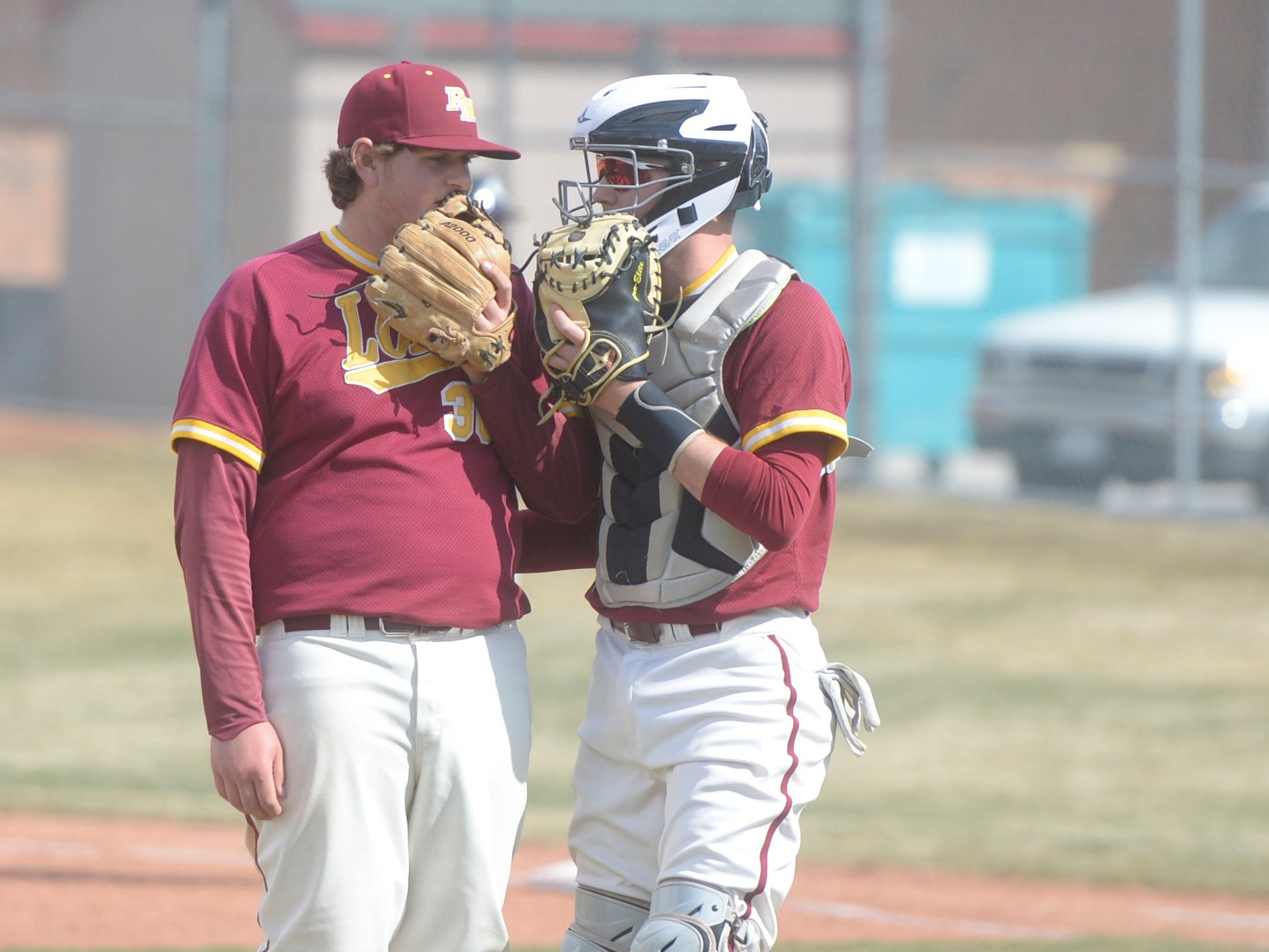Rocky Mountain baseball pitcher Cade Nelson, left, and catcher Jaren Piepho discuss signs during a game Wednesday, April 3, 2019 against Mountain Vista. Mountain Vista won 10-2.