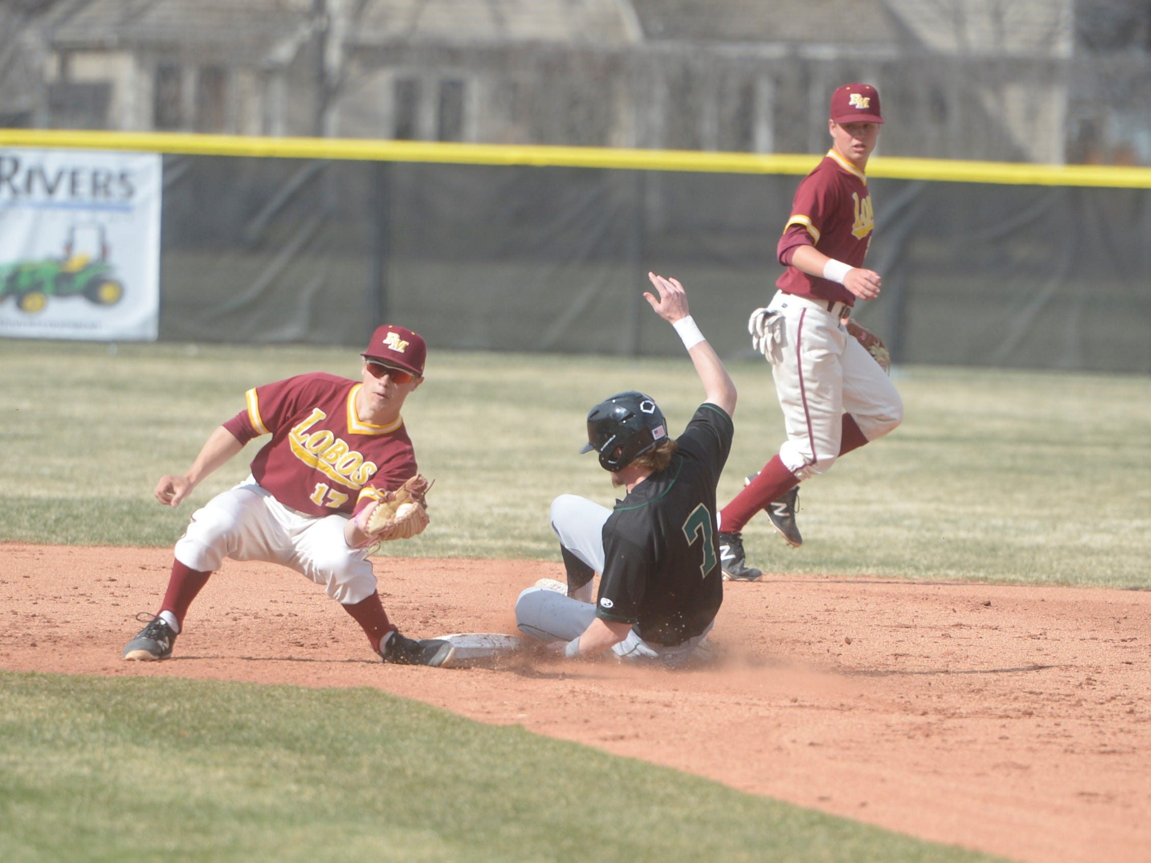 Rocky Mountain baseball second baseman Garrett Fisher attempts to tag out a base stealer during a game Wednesday, April 3, 2019 against Mountain Vista. Mountain Vista won 10-2.