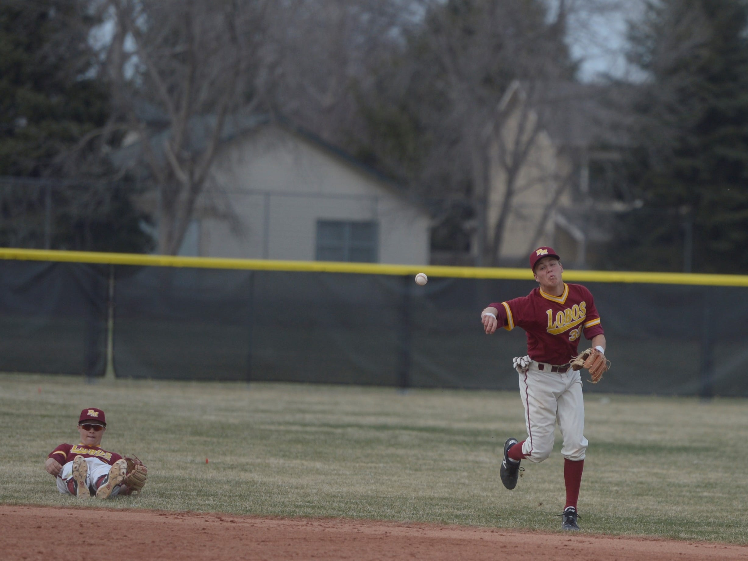 Rocky Mountain baseball shortstop Will Vasseur throws to first while second baseman Garrett Fisher looks on after a play up the middle during a game Wednesday, April 3, 2019 against Mountain Vista. Mountain Vista won 10-2.