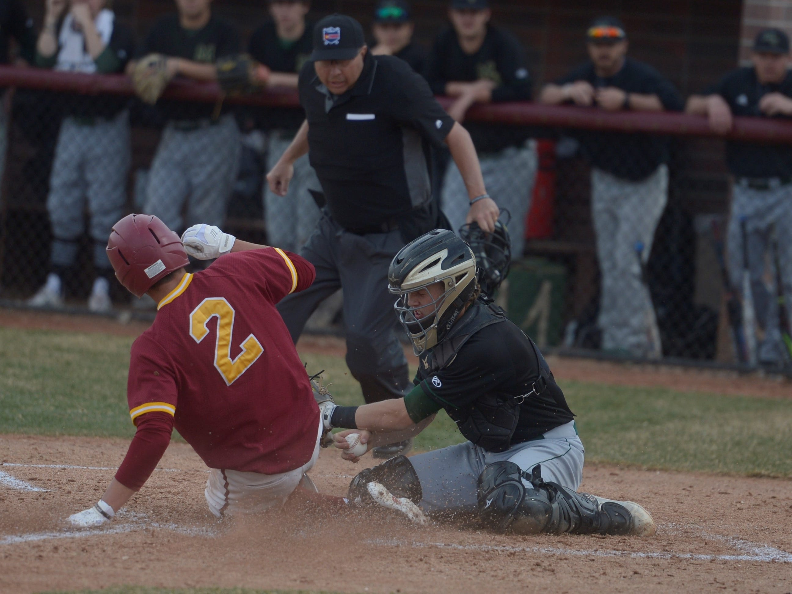 Rocky Mountain baseball player Dylan Hupfer is tagged out at home during a game Wednesday, April 3, 2019 against Mountain Vista. Mountain Vista won 10-2.