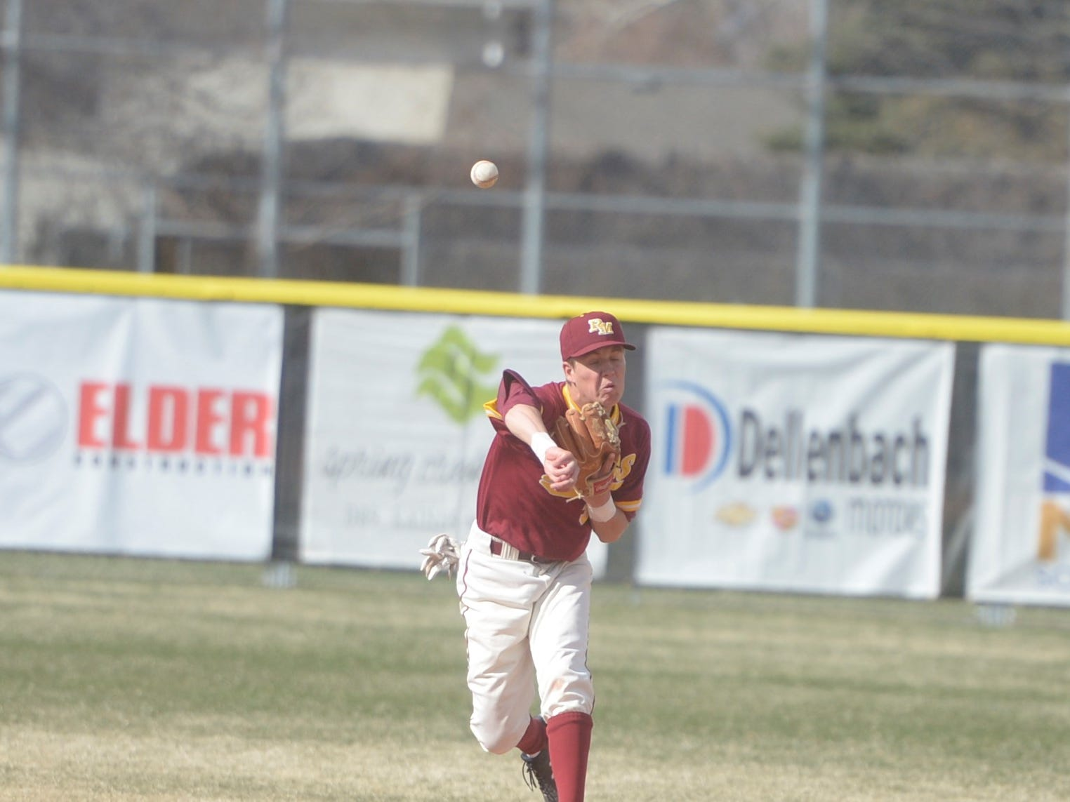 Rocky Mountain baseball shortstop Will Vasseur throws to first during a game Wednesday, April 3, 2019 against Mountain Vista. Mountain Vista won 10-2.