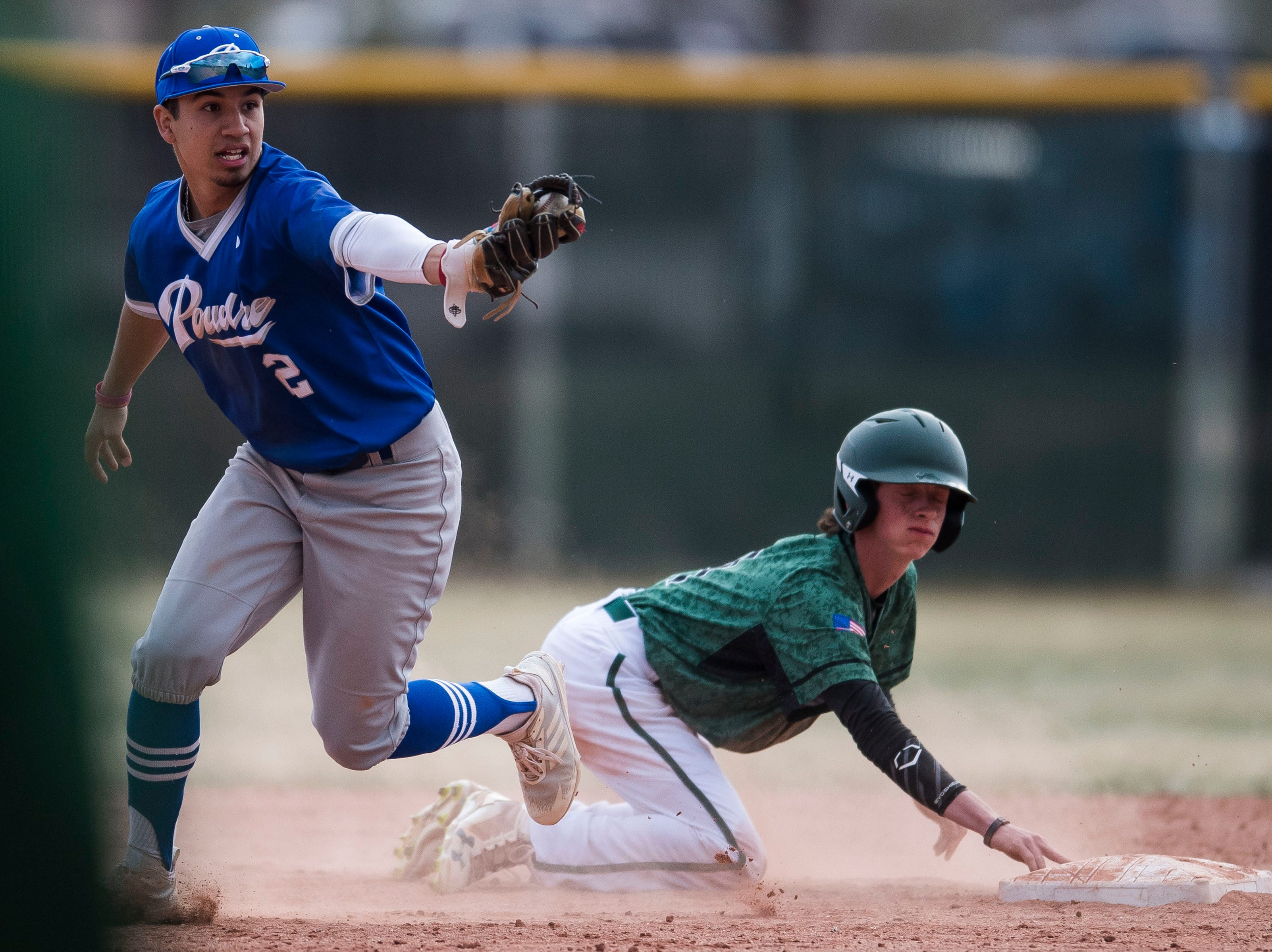 Poudre High School shortstop Sergio Tarango reacts after tagging out (2) Fossil Ridge High School runner Sam Cosper (4) at second base on Wednesday, April 3, 2019, at Fossil Ridge High School in Fort Collins, Colo.