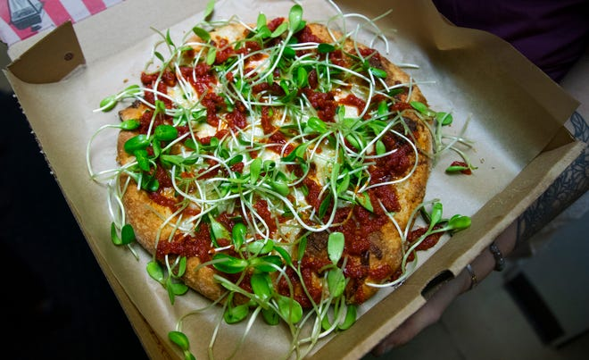Sun-dried tomato pesto pie is among the offerings at Danger Danger restaurant in Cape Coral. The pie features sun-dried tomato pesto, fresh mozzarella, sprouts, garlic and parmesan.