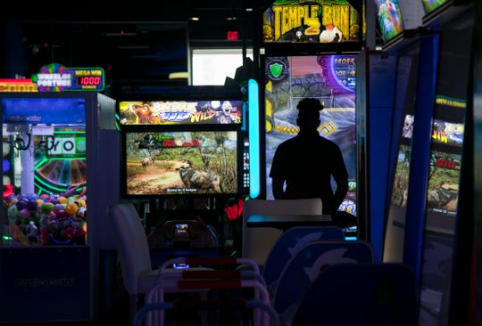 Corporate trainer Malcolm Mitchell checks on video games at Dave and Busters on Thursday, April 4, 2019, in Fort Myers.
