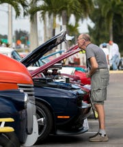 Ed Wengorek of Cape Coral checks out one of the cars at the Hot Chili Rods Cruise-In at Foster's Grille in Cape Coral on Wednesday, April 3, 2019.