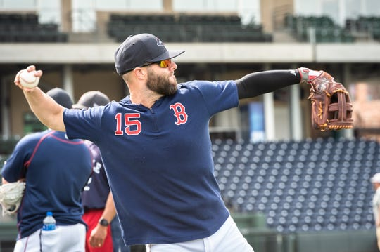 Boston Red Sox second baseman Dustin Pedroia warms up at Fluor Field with the Greenville Drive before their game against the West Virgina Power Apr. 4, 2019. The Greenville Drive is hosting Pedroia while on a major league injury rehab assignment this weekend