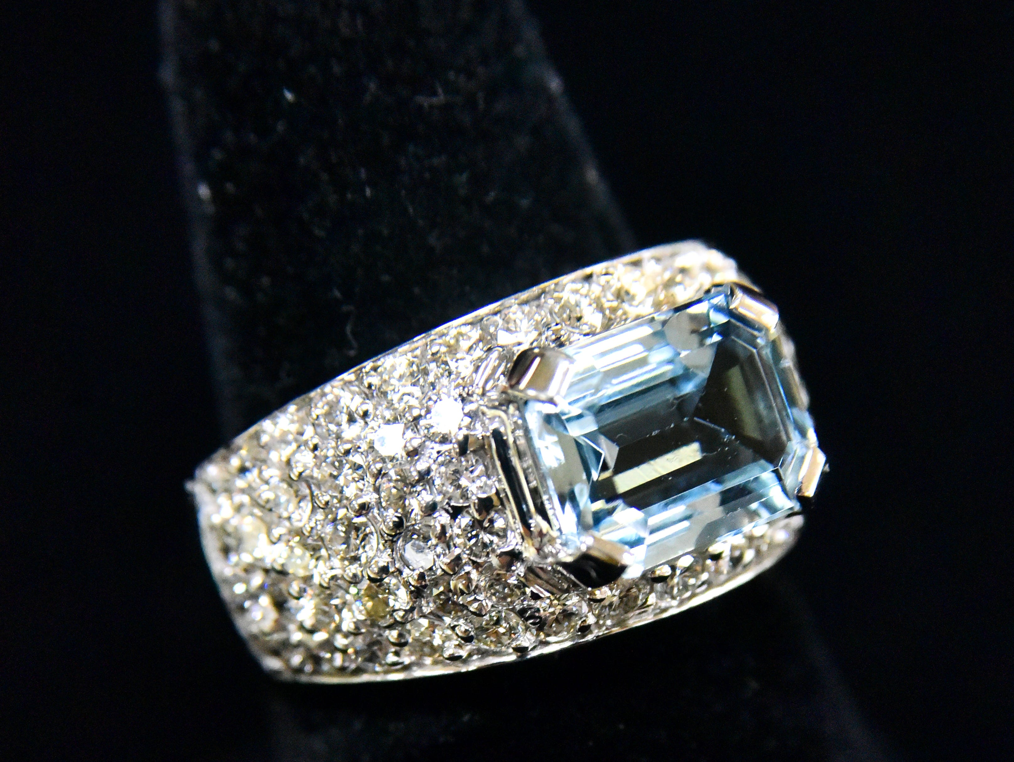 A 4k aquamarine ring with 2K in diamonds.