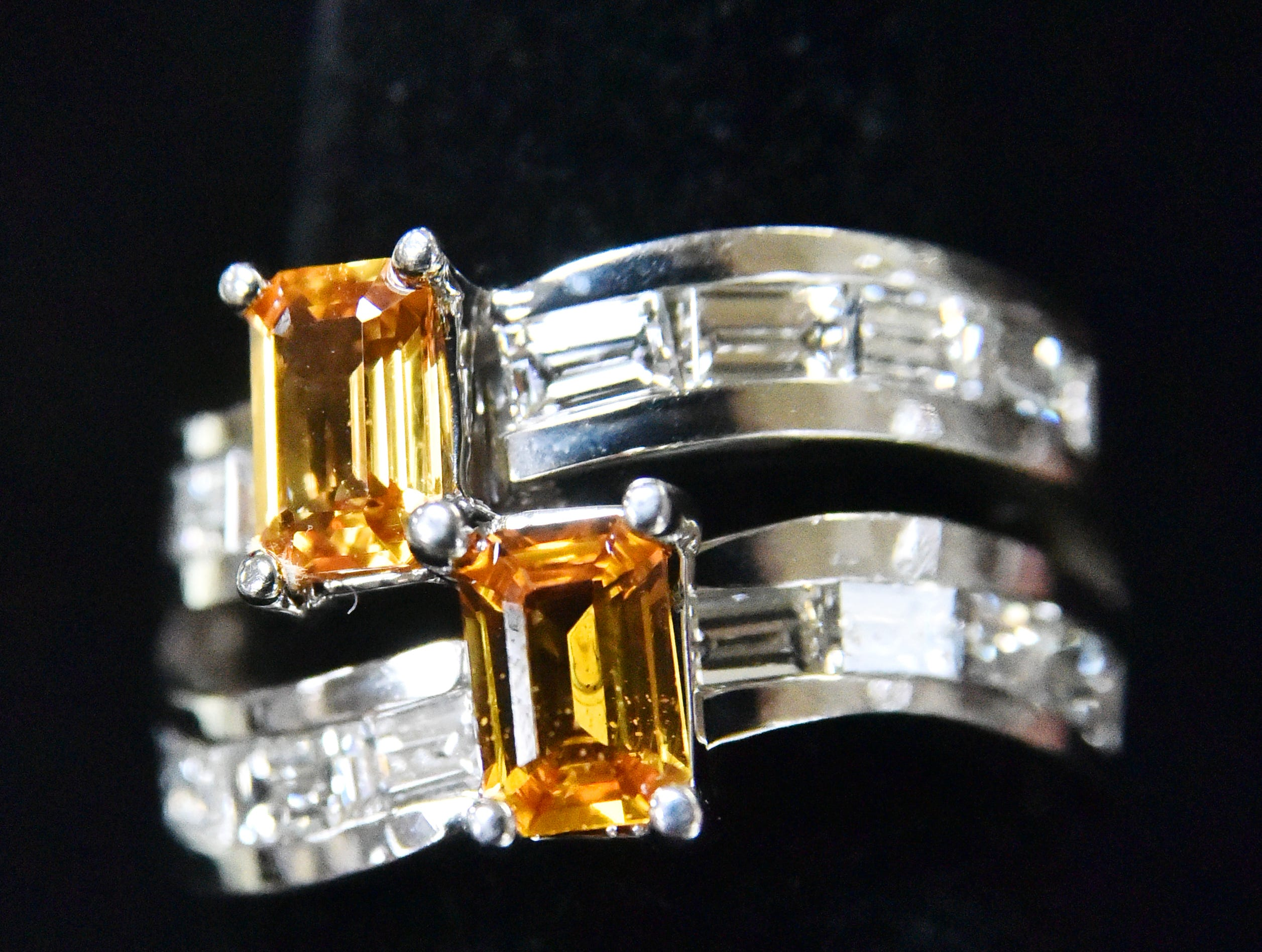 A ring with matching 1K yellow sapphires and 2K in baguette diamonds from Julie's Jewels and Gifts.