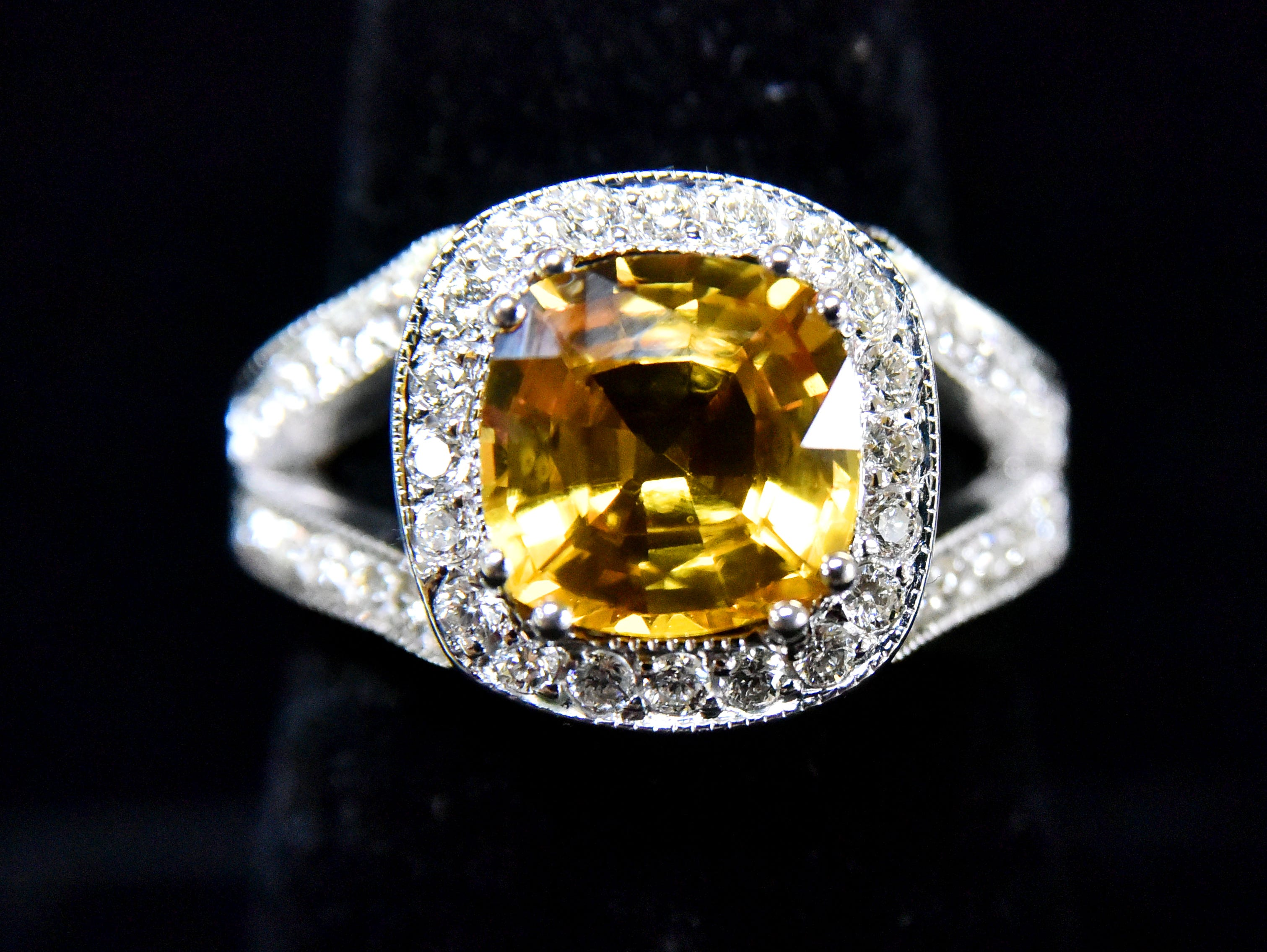 A 3.5k natural yellow sapphire ring with 1.25k in diamonds.