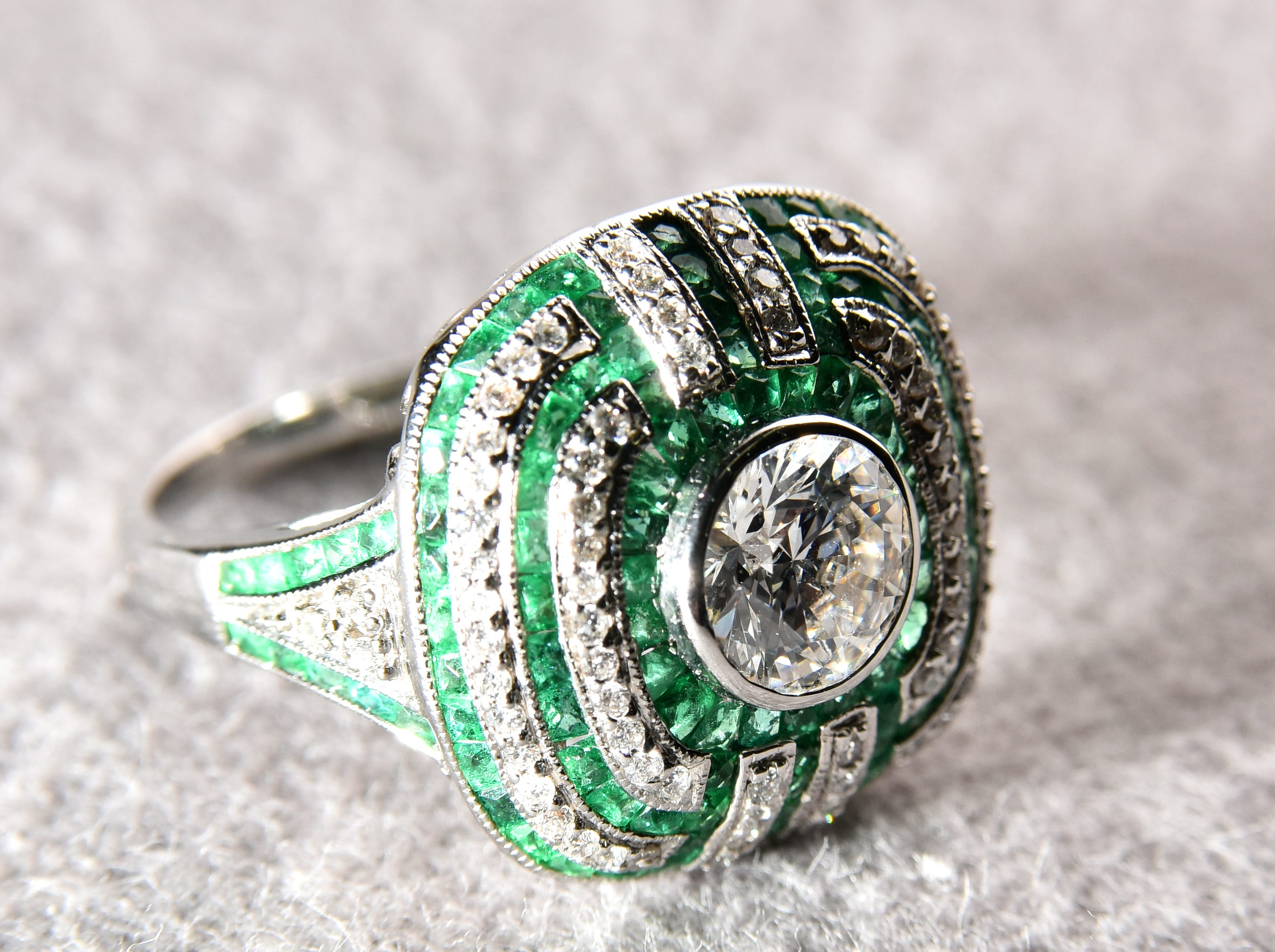An emerald and diamond ring from Pace Jewelers.