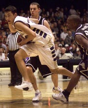 Montana State's Pete Conway drives between Weber State's John Hamilton and Chris Woods, right, on March 3, 2001, in Bozeman. Montana State won 92-87.