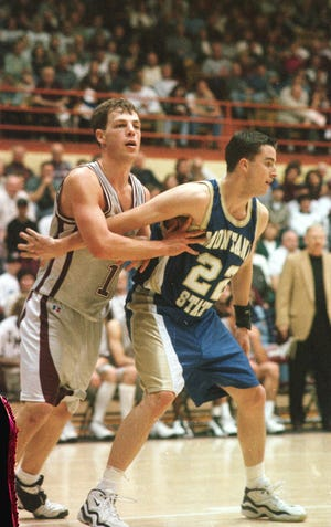 -  Montana State's Danny Sprinkle, right, battles for position with Great Falls native Mike Warhank of the University of Montana in 1998. Sprinkle on Thursday was named new Montana State men's basketball head coach.