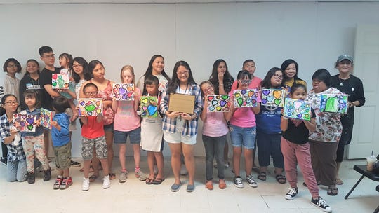 The Down Syndrome Association of Guam with the assistance of George Washington High School, parenting and art class students and teachers held  two painting events on Jan. 19 and Feb. 9  at Agana Shopping Center for individuals with Down Syndrome.