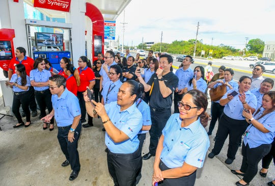 Mobil Oil Guam employees and guests attend a ribbon cutting ceremony celebrated at the Mobil fueling station in Tamuning on Thursday, April 4, 2019.