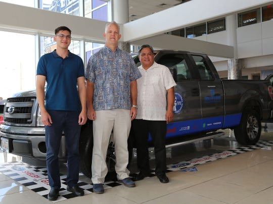 Jay Jones, Senior Vice President of Triple J Enterprises, Inc. (center) presents a Ford F-150 pickup truck to Guam Football Association President Tino San Gil (right) and General Secretary Micah Paulino (left) during a presentation event at the Triple J Auto Group showroom last week.