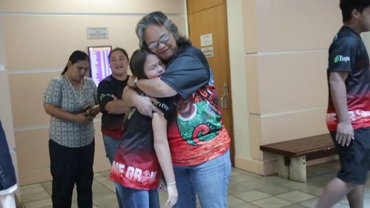 Eleanor Manglona San Nicolas hugs Leebrick Manglona's daughter, Tamiya Penaflor, after Jonathan Pangelinan was sentenced for Manglona's death on April 4 in the Guam Judicial Center in Hagåtña.