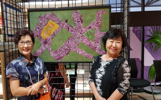 Yeon Sook Park with Linda Suda at the 14th annual Women's Art Show, in honor of Women's History Month at the Nissan Infiniti Art Gallery on March 15. The event was in conjunction with Soroptimist International Guam, Guam Council of Women's Clubs, Guam Council on the Arts & Humanities Agency, Department of Chamorro Affairs, and Isla Center for the Arts.