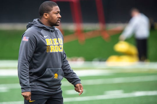 Iowa running backs coach Derrick Foster calls out instructions to players during a Hawkeye football spring practice on Thursday, April 4, 2019, at the University of Iowa outdoor practice facility in Iowa City, Iowa.