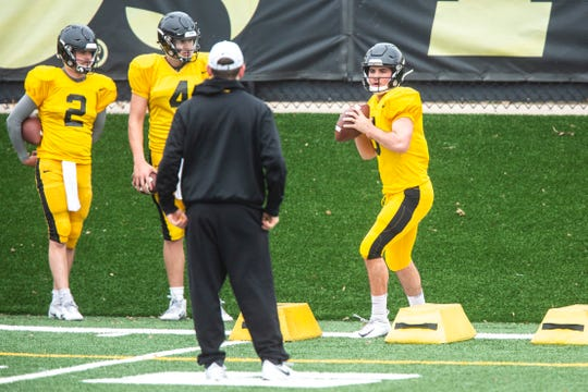 Iowa freshman quarterback Alex Padilla (8) runs a drill while Peyton Mansell (2) and Nate Stanley (4) wait their turn during an April 4 open practice in Iowa City.