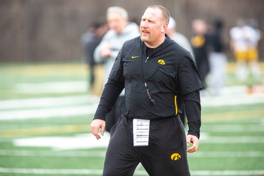 Iowa offensive line coach Tim Polasek calls out to players during a Hawkeye football spring practice on Thursday, April 4, 2019, at the University of Iowa outdoor practice facility in Iowa City, Iowa.