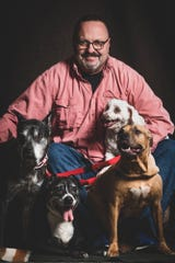 Al Ignance with his pack of senior dogs, ranging from 14-15 years old.