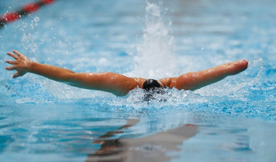 Paralympic athlete and Indiana native, Lizzi Smith, practices her butterfly stroke at the U.S. Paralympics National Championships, held at the IUPUI Natatorium  in Indianapolis on Wednesday, April 3, 2019.