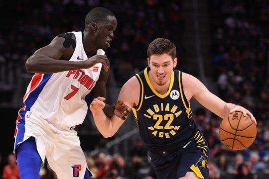 Apr 3, 2019; Detroit, MI, USA; Indiana Pacers forward T.J. Leaf (22) drives to the basket against Detroit Pistons forward Thon Maker (7) during the second quarter at Little Caesars Arena. Mandatory Credit: Tim Fuller-USA TODAY Sports