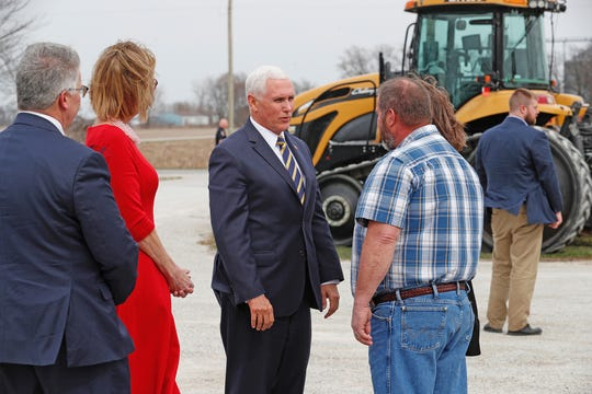 Vice President Mike Pence speaks with Dean Lamb and his wife Debbie at Lamb Farms in Lebanon on Thursday, April 4, 2019. Pence arrived in Indiana to speak with farmers just northwest of Indianapolis about the trade pact that the White House wants to replace NAFTA.