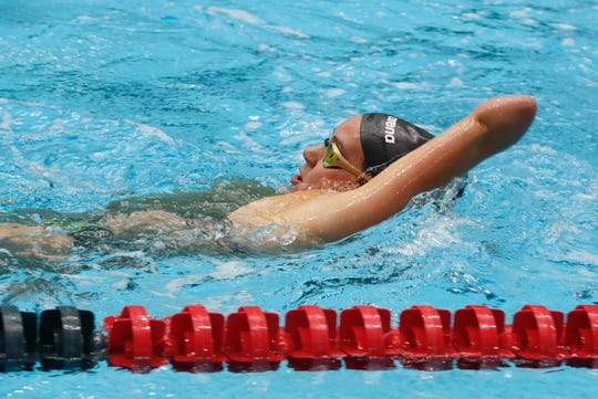 Paralympic athlete and Indiana native, Lizzi Smith, works out in the pool at the U.S. Paralympics National Championships, held at the IUPUI Natatorium  in Indianapolis on Wednesday, April 3, 2019.