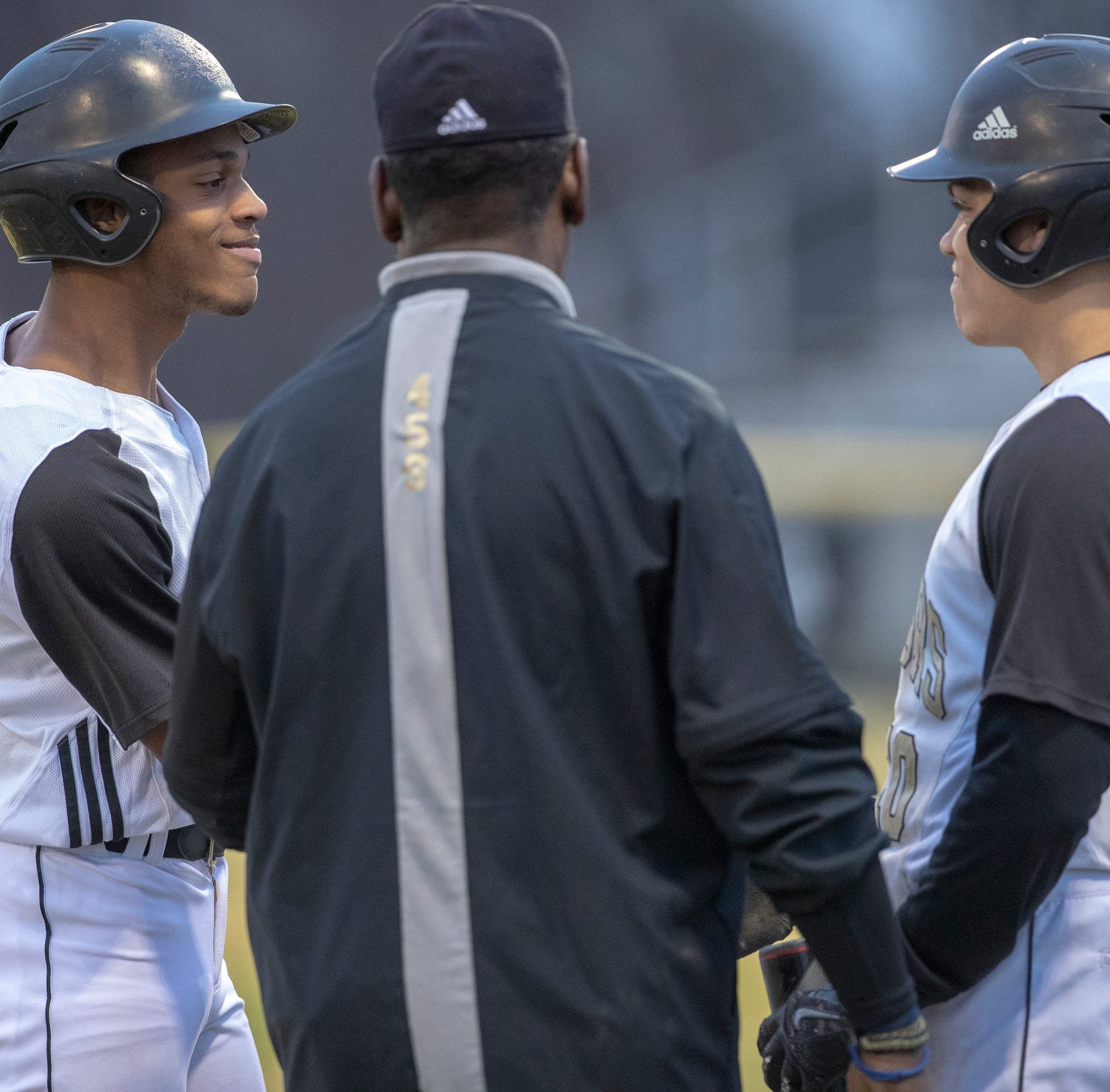 Hunter Shanklin (left), during a game against Pike High School, at Warren Central High School, Indianapolis, Wednesday, April 3, 2019. Shanklin broke his leg last fall while playing football for the school, and is playing baseball this Spring with few limitations.