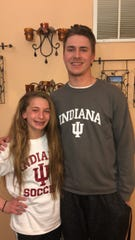 Lexi Watkins (left) with her brother, Dillon, after she verbally committed to play soccer for IU.