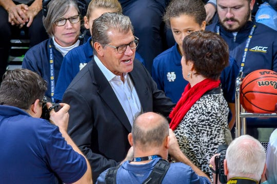 Connecticut coach Geno Auriemma and Notre Dame coach Muffet McGraw shake hands before the game at the Purcell Pavilion in December.
