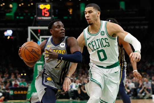 Mar 29, 2019; Boston, MA, USA; Indiana Pacers guard Darren Collison (2) drives the ball against Boston Celtics forward Jayson Tatum (0) in the first quarter at TD Garden.
