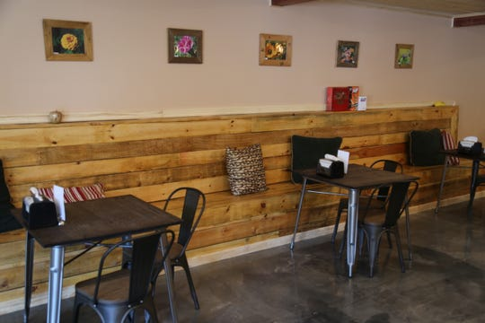 The furniture and interior design of Brewer's Cafe & Taproom contributes to the business' homey atmosphere.