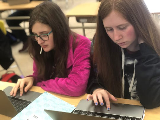 Danielle Harris and Jessie Lovell, students at Crockett County High School, work on their assignments during computer science class.