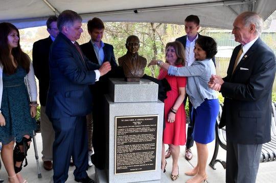 The Kisber Family unveil the bust of Jonas A. Kisber, Jr. at the dedication of his memorial roundabout, Thursday, April 4.