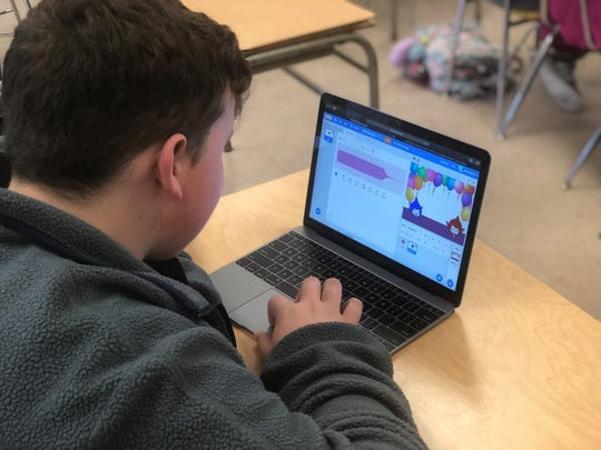 Jayden Hart, a student in the entry-level computer science class at Crockett County High School, creates a character to tell knock-knock jokes, dance and laugh during class Wednesday.