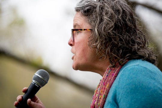 Moira Connelly speaks at a rally organized by AKIN against the Knox County Sheriff's Department participation in 287(g) outside of the City County Building in Knoxville, Tennessee on Thursday, April 4, 2019. Around 400 collected postcards will be delivered to the sheriff's department on Friday morning.