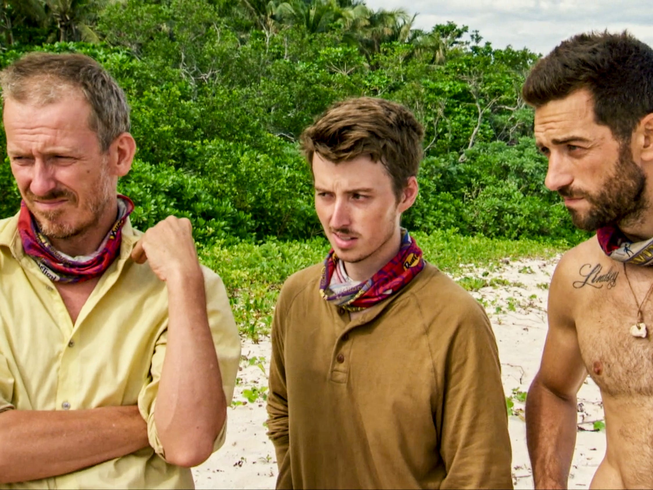 "Ron Clark, Gavin Whitson and Eric Hafemann stand together on ""Survivor: Edge of Extinction."""