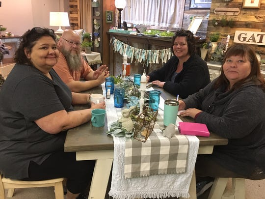 The Southern Sweet Tea and Junkin' Fair and Becca's Attic are very much family-and-friends affairs. Here, friend Angela Van Buren, Michael and Becca Gibson, and Becca's sister Teressa Gregory have a planning session for the Fair. April 3, 2019.