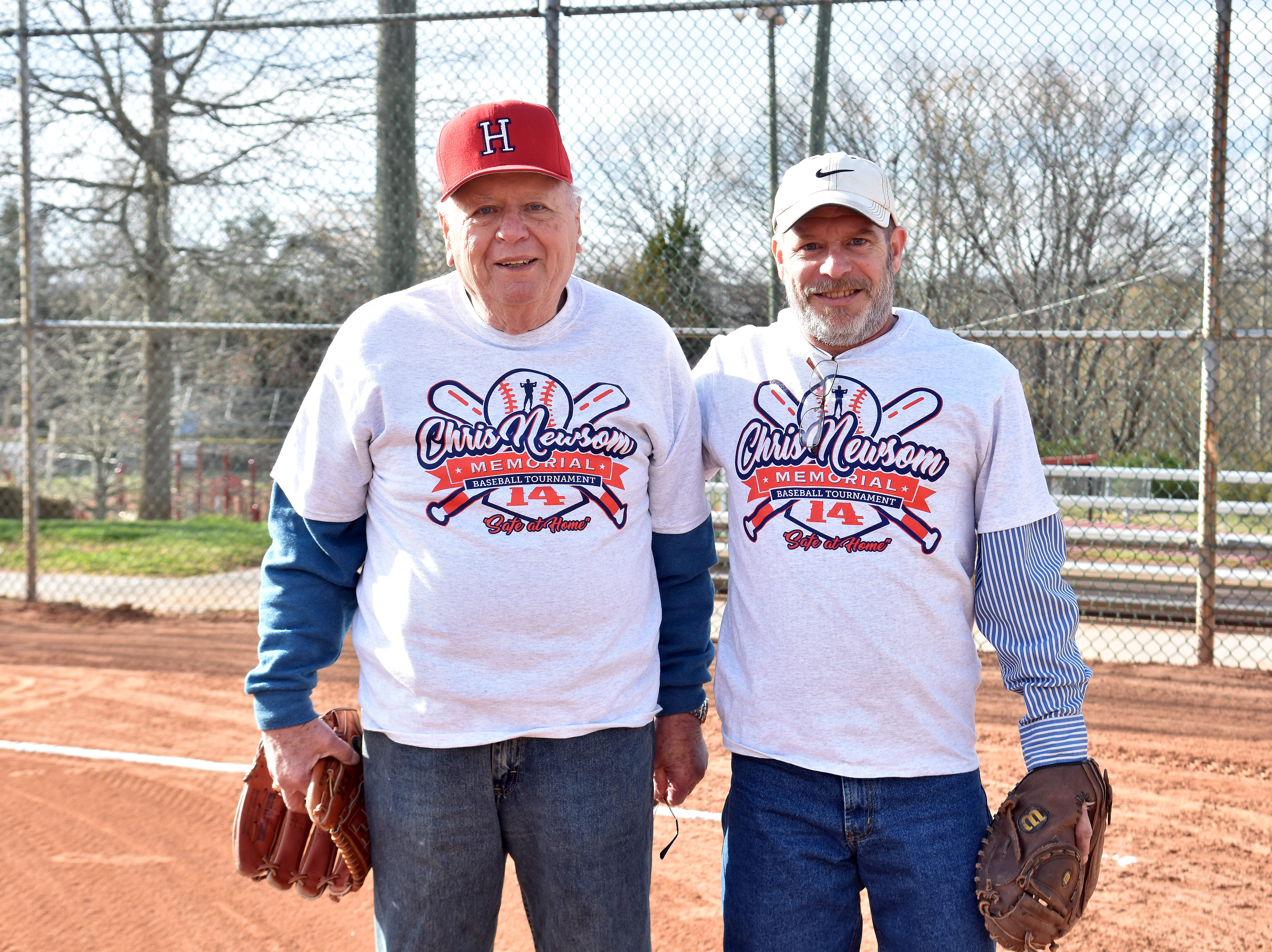Chris Newsom's dad, Hugh, left, has thrown out the first pitch of the Chris Newsom Memorial Tournament since it began in 2008. Chris's brother Dennis Perry served as catcher for Hugh at the official opening of the tournament this year.