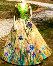 """Any elegant lady would have trouble resisting this dress – even if it is made of newspapers. Cheryl Burchett made it for the  Knoxville News Sentinel's """"Newspaper Fashion Challenge."""""""