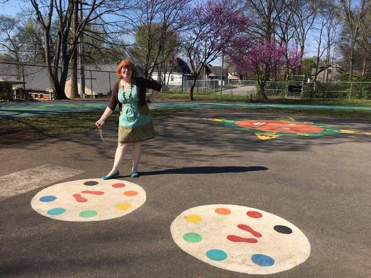 "Cheryl Burchett created a ""mirror me"" game on the playground. One child stands on the footprints in one circle; another stands in the other. The follower must match the leader's moves."