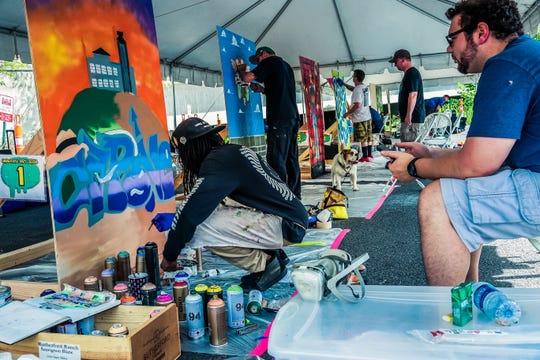 Participants take part in Alcatraz East Crime Museum's Graffiti Art Contest.