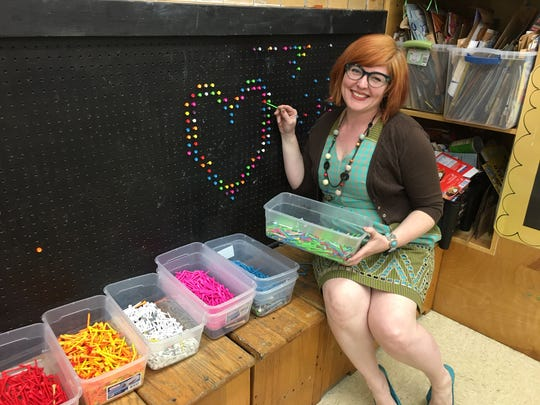 """Cheryl Burchett won't let empty wall space go to waste. When a set of storage shelves proved shorter than she expected, she installed a pegboard and some colored golf tees. Now the kids in her classes have a life-sized """"Lite-Brite"""" that never gets finished."""