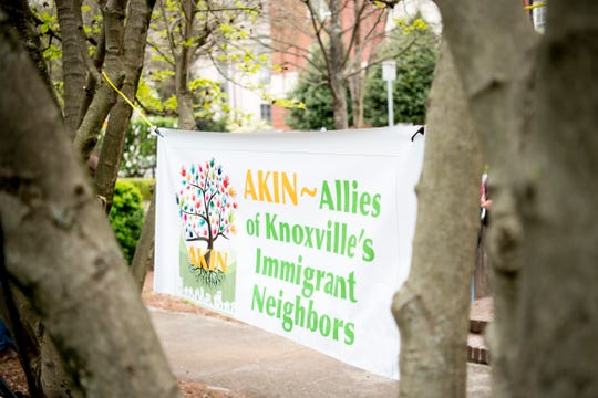 A banner hangs at a rally organized by AKIN against the Knox County Sheriff's Office's participation in the 287(g) program April 4, 2019.